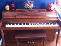 Baldwin Acrosonic upright piano with bench. Piano is in