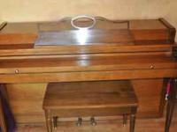 Beautiful upright Howard spinet piano made by Baldwin.