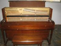 Baldwin upright piano in very nice condition. Must