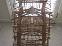 Bamboo and wooden decorative birdcage. 40 inches tall