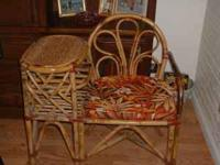Bamboo chair with attached phone table and pad. Good