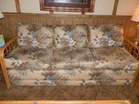 Bamboo fold out sleeper sofa for sale. Color is cream