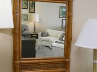"Bamboo wicker mirror with the measurements of 42"" tall"