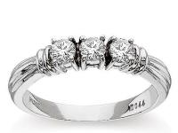 An elegant triple-banded motif graces this ring and is