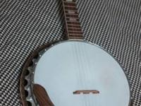 I have a banjo of an unidentified brand and a Kentucky