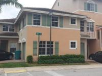 Large bright and airy 3/2 condo with attached garage in