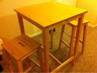 This is a bar-height kitchen table and two stools,