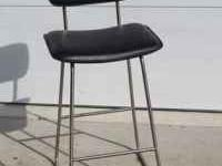 Black and stainless steel bar stool in excellent