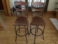 2 swivel bar stools that measure 29' tall at the seat.