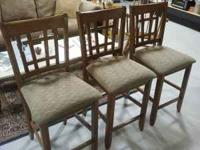 For sale are 3 sturdy, upholstered seat bar stools.