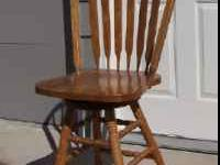 "Solid oak,swivel bar stools 24"" seat heigth, 17 1/2"""