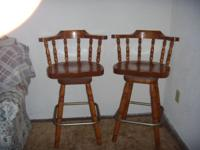 I have 2 wooden swivel bar stools in good condition. We