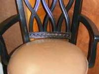 2 Bar Stools, black with tan seats. They have footrest,