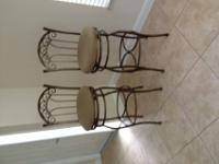 Two bar stools sold as a set. Mocha colored seats.