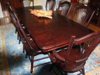 I am selling a beautiful bar style dinette table with