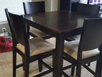 Dark wood bar table, four chairs included. Table is in