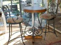 Bar table and two bar stools. Wood and metal legs,
