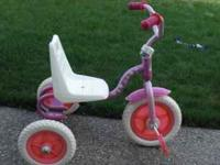 A very good condition Barbie Tricycle w/ Adjustable