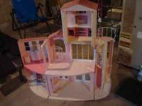 This is a great dollhouse for any little girl. It has a