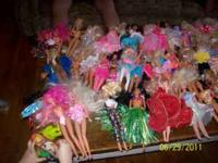 Between 50 to 55 barbie dolls from 1990's not in boxes