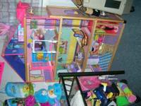 For sale 4 story Barbie doll house with furniture.