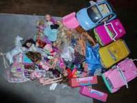 Barbie cars, dolls, clothes and accessories. Looking