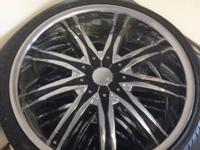 22 inch chrome and black rims on the tires for sale. I