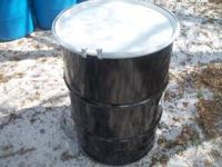 METAL BARREL WITH A . METAL RING THAT KEEPS THE LID IN