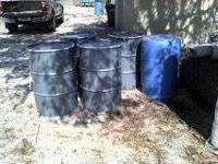 I HAVE 8 METAL BARRELS FOR SALE WITH LIDS VERY GOOD