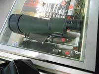 WE HAVE FOR SALE A BARSKA BENCHMARK SPOTTING SCOPE  IT