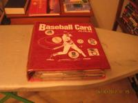 This is a notebook filled with baseball cards. All top