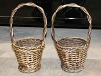 Two tall heavy wicker baskets, 21.5 inches tall, 11
