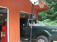 Basket ball hoop with stand.  Call  show contact info