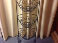 Very uncommon tall black metal stand with three black