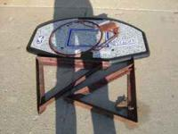 This is a plastic backboard with a hoop to go on it and