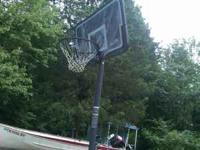 Rarely used free standing adjustable basketball goal.