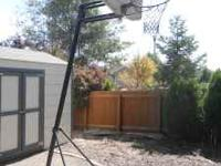 This is a portable basketball hoop. Adjustable heights