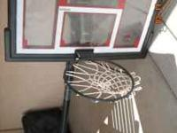 basket hoop free standing with stand-brand new- $60.00