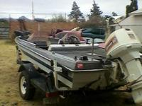 1986 Glassport, 90hp Johnson 1989 outboard. Has 2 live