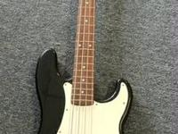 Bass Guitar Squire by Fender. Made in Indonesia. In