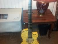 I am selling a Five String DEAN Electric Acoustic