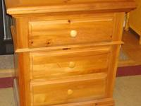 This is a great three drawer chest in pine finish made