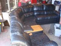 Bassett black leather sectional with dual recliners.