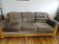 We have a clean bassett sofa. Medium brown in color.