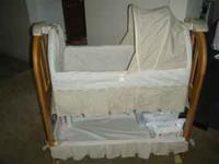 Eddie Bauer Musical Rocking Bassinet Babies love