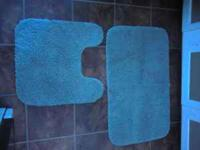 Light Blue Bath Mat with toilet circle. Red bath mat