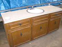Bathroom cabinet with sink, faucet and laminate top and