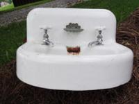 White Cast Iron Bathroom sink with gently used Faucets