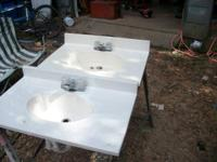 2 bath room  sinks 20.00 apiece 31 in  long used has
