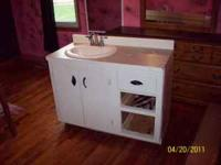 White homemade bathroom vanity with sink and faucet.